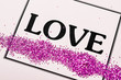 LOVE word with glitter in frame.