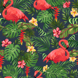 Seamless pattern with leaves of palm trees, exotic flowers and flamingo