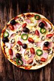 Pizza with Ham, Cherry Tomatoes, Mushrooms and Olives - 192161667