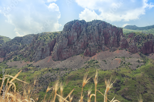Foto op Canvas Khaki View from the monastery of Noravank on red mountains, green hills and blue sky. Armenia.