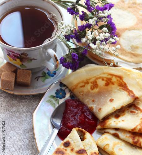 Tea with pancakes and jam..