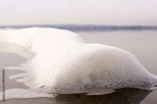 Foto op Plexiglas Natuur foam from the pipe on the water surface