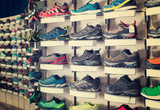 Image of large selection of sport shoes in store. - 192173811