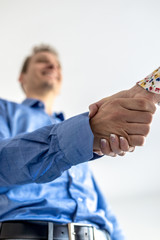 Businessman in blue shirt shaking hands