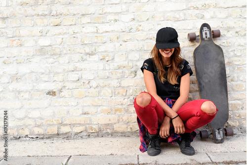 Fotobehang Skateboard Cute trendy urban girl with longboard outdoors