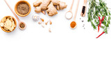 Seasoning background. Dry spices near ginger, garlic, rosemary, chili on white background top view copy space - 192183071
