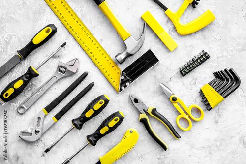 Various repair tools. Must-have for men. Equipment for building. Repair tool kit. Grey background top view pattern