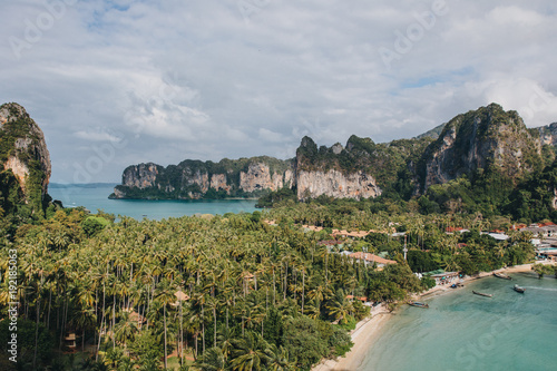 Fotobehang Zomer scenic view of sandy beach with green trees and rocks at Krabi, Thailand