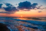 Beautiful sunset on an empty sandy beach.