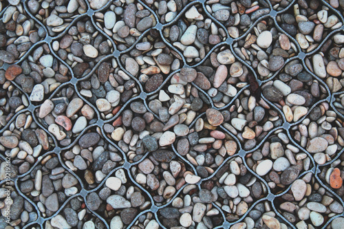 Fotobehang Stenen Pebbles in a lattice