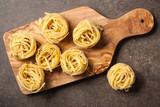 Uncooked pasta on kitchen table - 192200855