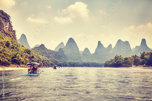 Fotobehang Beige Retro toned picture of the Li River (Li Jiang) with bamboo rafts, China.