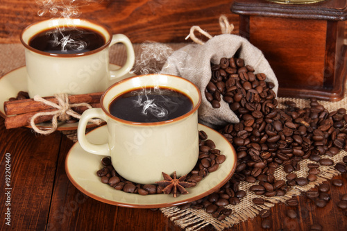 Papiers peints Cafe a linen bag full of coffee beans with a cup of freshly brewed black coffee