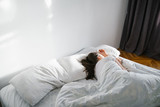 woman sleep in bed sunshine thought the window - 192204647