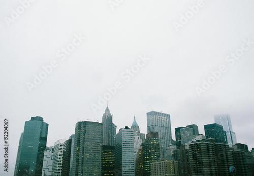 Fotobehang Brooklyn Bridge Skyline of buildings next to the Brooklyn Bridge in the USA