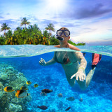 Young woman at snorkeling in the tropical water - 192217861