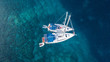 Aerial view of two anchoring yacht in open water.