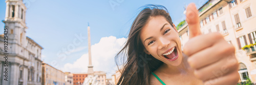 Happy travel fun Asian tourist girl doing thumbs up in Rome vacation, Italy. Europe summer vacation woman banner panorama.