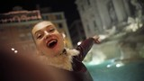 Happy young girl with red lips taking selfie smiling waving his hands night city woman winter technology female phone smartphone street cellphone romantic italy rome portait close up attractive - 192237475