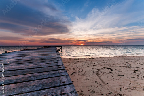 seascape sunset with wooden jetty.