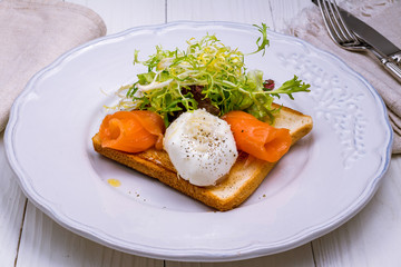 Toast with poached egg and salmon