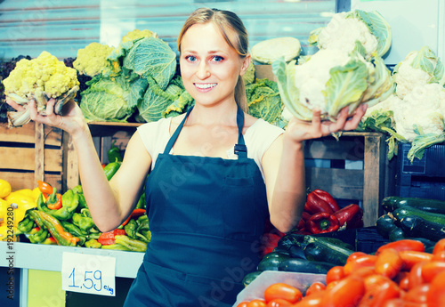 woman  selling fresh cabbage