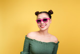 Stylish beautiful young woman in sunglasses against yellow background. - 192263290