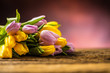 Tulips. Bouquet of Spring tulips yellow and pink on wooden table