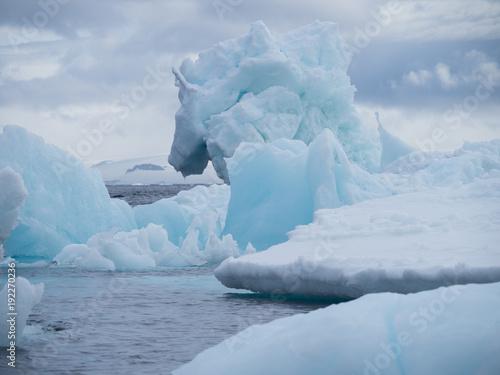 Tuinposter Antarctica Light blue, light turquoise and gray Iceberg at Esperanza in Antarctica