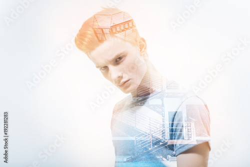 Foto op Aluminium Kapsalon Handsome. Calm smart attractive man in a Tshirt leaning his head and thoughtfully looking in front of himself