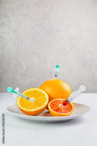 fresh juicy fruits on a plate processed with chemicals
