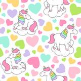 Cute pastel unicorn and heart seamless pattern background