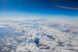 Plane window view with blue sky and clouds. - 192292620