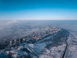 city view from a bird's eye view to a winter city at dawn in the fog - 192293295