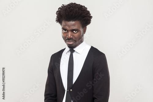 Dramatic afro man cry and looking at camera.