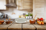 Food ingredients in kitchen placed on wooden plank