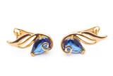beautiful photo close up gold earrings, precious stones, diamonds, costume jewelry, jewelry