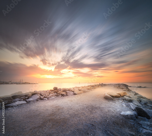 Deurstickers Barcelona Stone beach shore Barcelona at dramatic sunrise