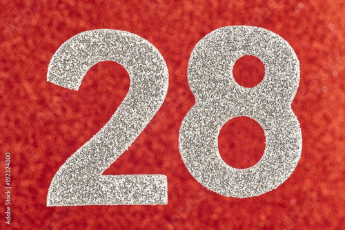 Poster Number twenty-eight silver color over a red background