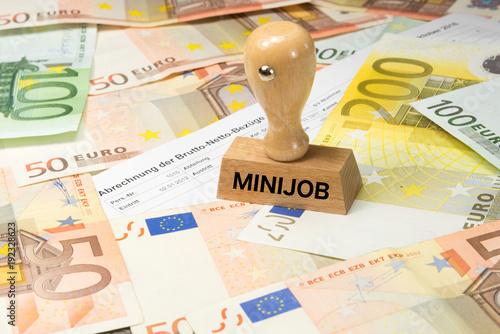 canvas print picture Eine Lohnabrechnung, Euro Geldscheine und ein Stempel mit dem Aufdruck Minijob