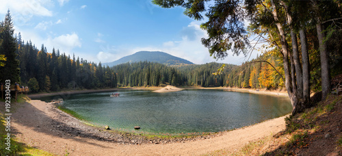 Lake in the mountains surroundes by pine trees