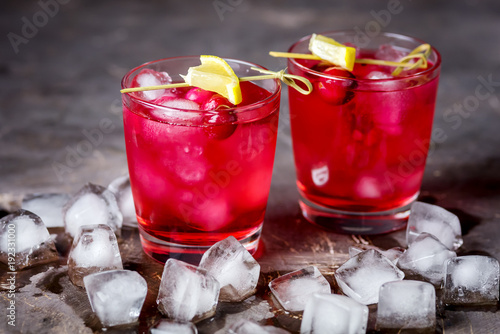 Two Glasses of Berries Cold Drink Tasty Cranberry Lemonade with Ice Dark Photo Black Background Horizontal