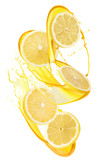 lemon slices in juice splash isolated on a white background