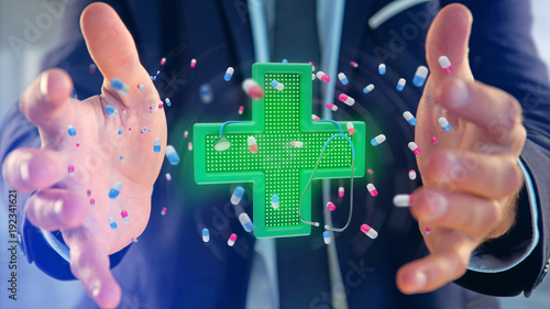 Staande foto Apotheek Businessman holding a Lighting pharmacy cross and a stethoscope - 3d render