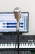 Home recording studio with microphone and midi keyboard.