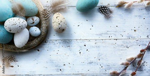 Easter background with Easter eggs on white table - 192356675