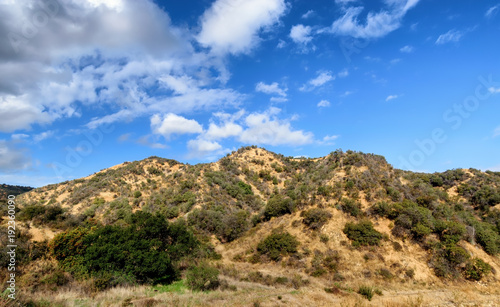 Foto Murales Morning clouds and sun over California hillside