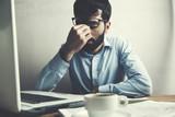 Businessman having a headache - 192373258
