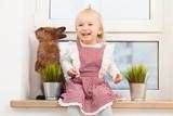 Cute little girl with a bunny - 192382489