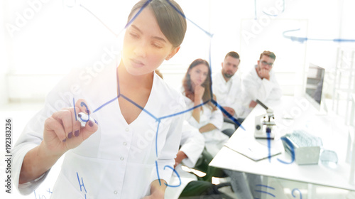 view through the transparent Board. female scientist makes a rep